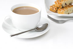 Cup of tea with three slices of cake Stock Images