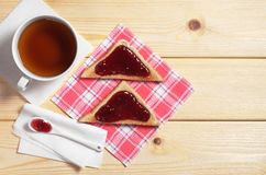 Tea and toasted bread with jam Stock Photo