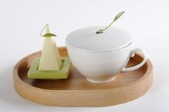 Cup of tea on a tray. On a white background Stock Photo