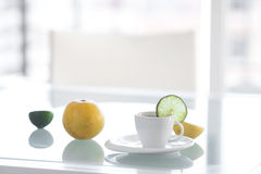 Cup of tea with tropical fruits Royalty Free Stock Photo