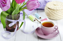 Cup of tea with tulips bouquet Stock Photography