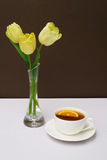 Cup of Tea and tulips Royalty Free Stock Images