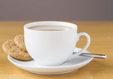 Cup of tea with two cookies Royalty Free Stock Image