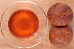 Cup of tea and two fresh buns Stock Photography