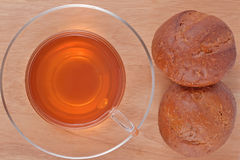 Cup of tea and two fresh buns Stock Image