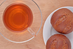 Cup of tea and two fresh buns Royalty Free Stock Photo