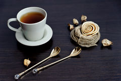 Cup of tea and two stylish teaspoons Royalty Free Stock Photo