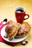 Cup of tea and two sweet buns Stock Photography