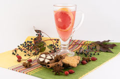 Cup of Tea. Up of tea, autumn leaves and fruits, sweets, on a white background royalty free stock photo