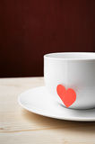 Cup of tea on valentine's day. Cup with delicious hot drink stands on a table Royalty Free Stock Image