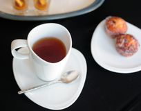 Cup of tea and various cakes Stock Photography