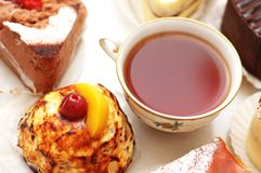 Cup of tea and various cakes Royalty Free Stock Images