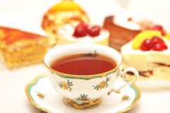Cup of tea and various cakes - Stock Image