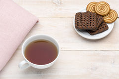 Cup of tea and various cookies Stock Photo