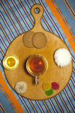 Cup of tea with various sweets Stock Image