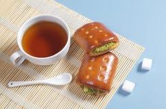 Tea and vegetable patties Stock Photo