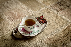 Cup of tea on vintage carpet Royalty Free Stock Photography