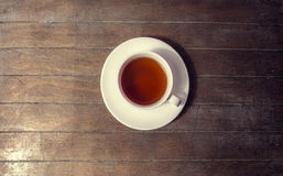 Cup of tea in vintage colour style. Royalty Free Stock Photo
