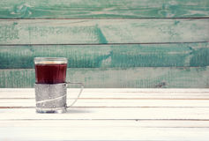 Cup of tea in vintage glass-holder Stock Photography