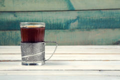 Cup of tea in vintage glass-holder Royalty Free Stock Image