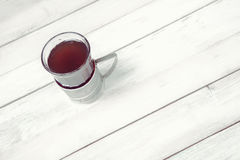 Cup of tea in vintage glass-holder Royalty Free Stock Images