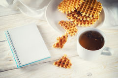Cup of tea, waffle and notepad Royalty Free Stock Images