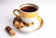 Cup of tea with waffles stock images
