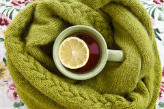 Cup of tea in warm scarf Stock Photos