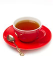 Cup of tea on a white background. Red cup of tea on a white background Royalty Free Stock Photography