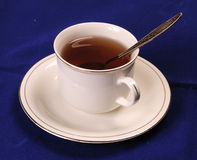 Cup of tea, white on blue background Royalty Free Stock Image