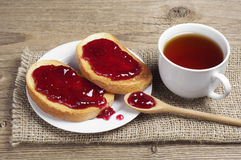 Cup of tea and white bread with strawberry jam Stock Images
