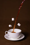 Cup of tea. White cup on a brown background. Sugar levitation vector illustration