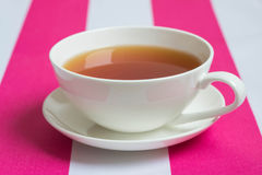 Cup of tea. On white-pink napkin stock images