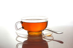 Cup of tea on white with reflection Royalty Free Stock Photography