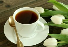 Cup of tea and white tulips Stock Photo