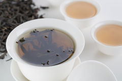 Cup of tea. White cup of tea on the white table. Tea set, Still Life, Chinese elements Royalty Free Stock Photography