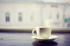 Cup of tea on a window Royalty Free Stock Image
