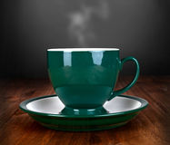Cup of tea on wood table Royalty Free Stock Images