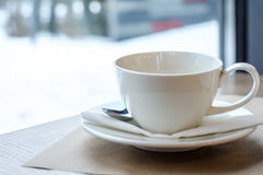 Cup of tea on a wood table in the restaurant. White winter background Stock Photography