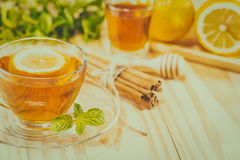 A cup of tea on the wood table. You can apply for background,bac Stock Images