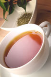 Cup of tea. On wooden background royalty free stock images