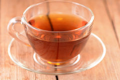 A cup of tea on wooden background Royalty Free Stock Photo