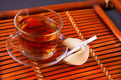 Cup of tea on a wooden background royalty free stock photos