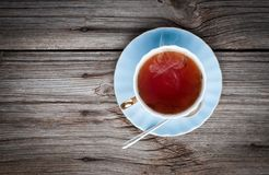 Cup of tea on a wooden background Stock Images