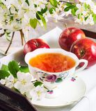 Cup of tea on wooden table and apple blossom. On vintage serving tray. Tea time concept Stock Images