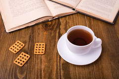 Cup of tea on wooden table with biscuit cookies Royalty Free Stock Photos
