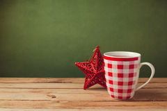 Cup of tea on wooden table with Christmas decoration Stock Photos
