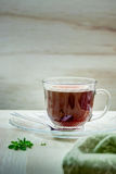 Cup of tea on a wooden table Royalty Free Stock Images
