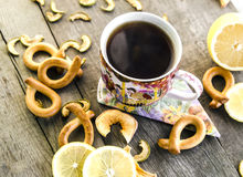 Cup of tea on a wooden table. Cup of tea with lemon on a wooden table Stock Photography