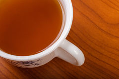 A cup of tea on a wooden table Stock Photos
